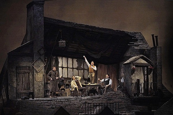 """A scene from Act I of Puccini's """"La Bohème."""""""