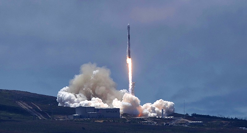 A SpaceX Falcon 9 rocket carrying two U.S.-German science satellites and five...