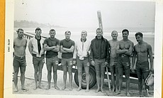 Lifeguards pose at the beach in San Diego, 1963.