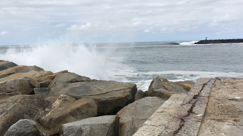 Waves on the breakwater at the mouth of Oceanside harbor, May 22, 2018.