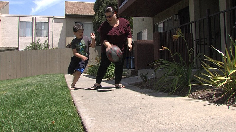 Charlene Holkenbrink-Monk pictured here playing ball with her six-year-old so...
