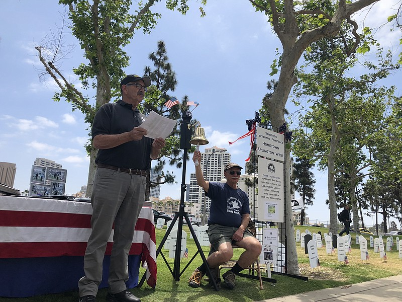 Jim Brown reads the names of the dead while Stan Levin rings the bell at Vete...
