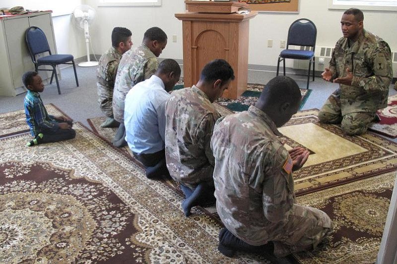 Lt. Col. Khallid Shabazz leads Friday prayer for the Muslim community of Join...