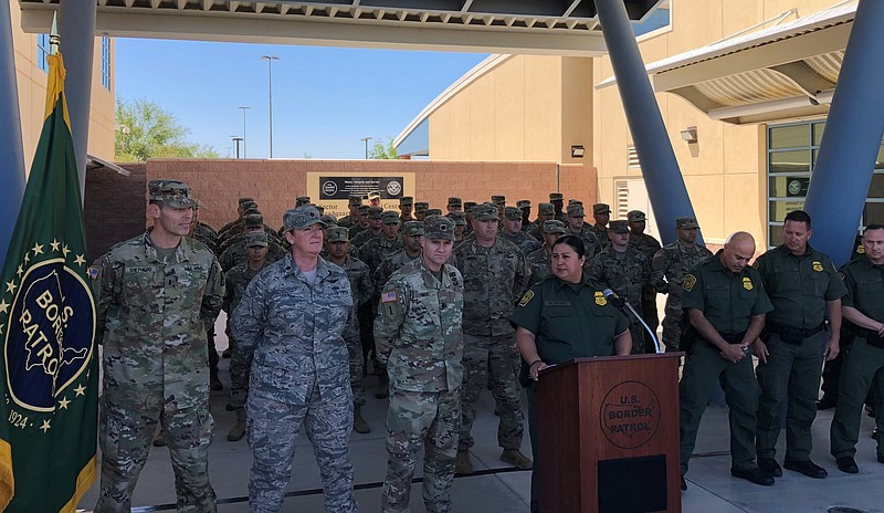 Members of the California National Guard line up behind El Centro Chief Borde...