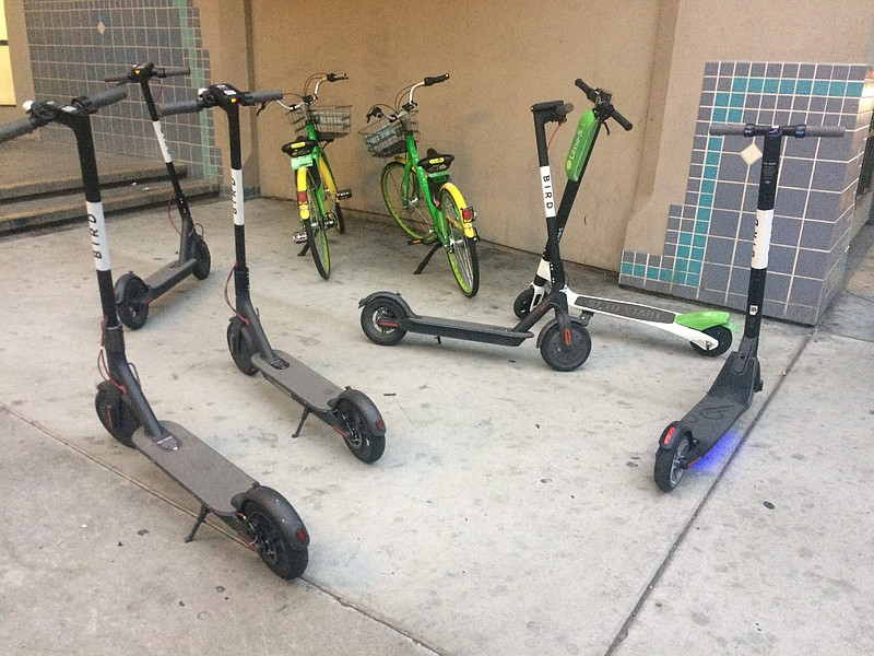 Dockless scooters are parked by Horton Plaza, downtown, May 30, 2018.