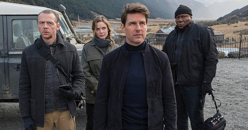 Tom Cruise (center) as Ethan Hunt reassembles his MI6 team with Simon Pegg, R...