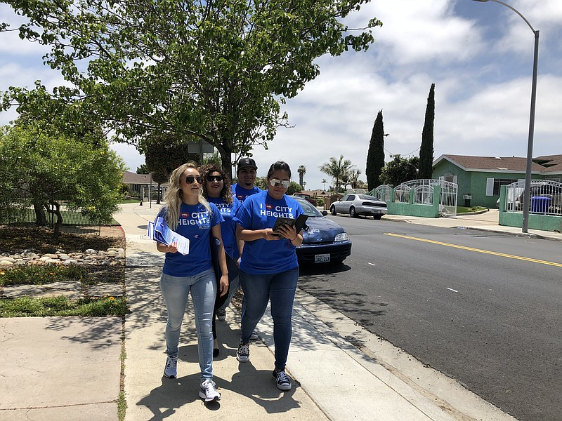 Mid-City CAN staff canvass a neighborhood to get out the vote, June 5, 2018.