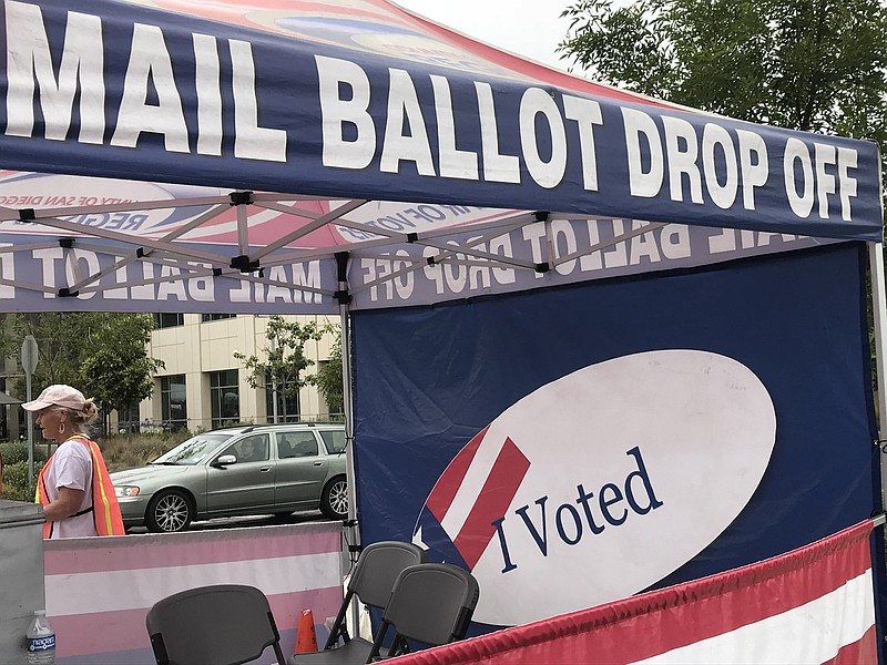 Voters drop off mail ballots at the San Diego County Registrar of Voters on O...