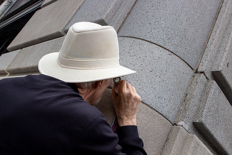 Geologist and SDSU Professor Emeritus Pat Abbott inspects the facade of the h...