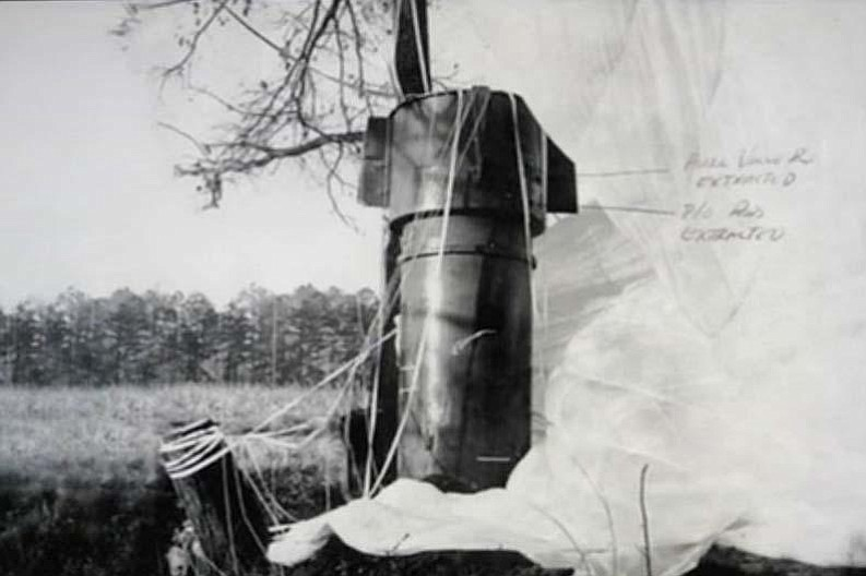 A nuclear bomb and its parachute rest in a field near Goldsboro, N.C. after f...