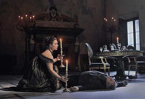 Sonya Yoncheva as Tosca and Željko Lučić as Scarpia in an...