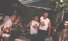 Charley's bartenders, c. 1980s. It was a countr...