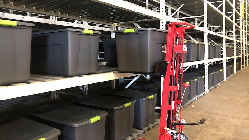 Inside the storage facility are 45-gallon bins that people can use to store n...