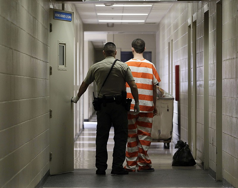 In this Feb. 21, 2013 file photo, an inmate at the Madera County Jail is take...