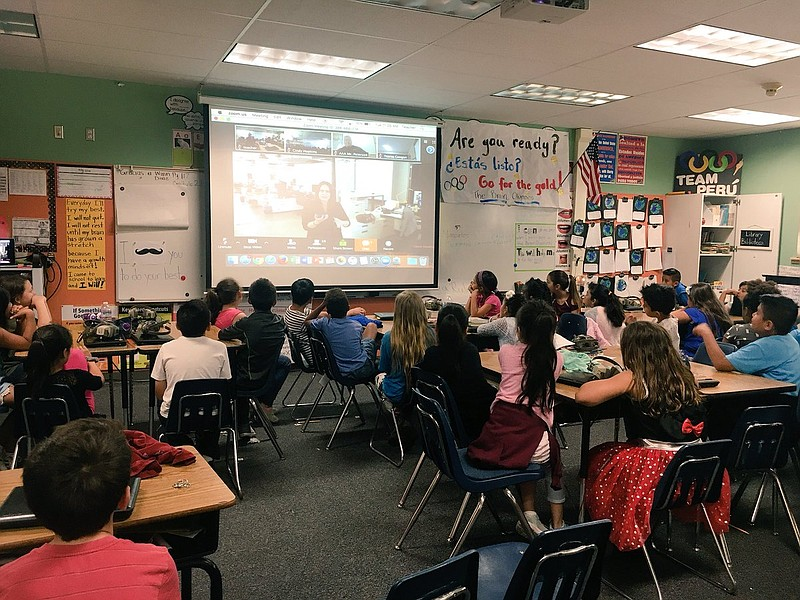 Third-graders at Bostonia Language Academy watch a virtual tour of the KPBS s...