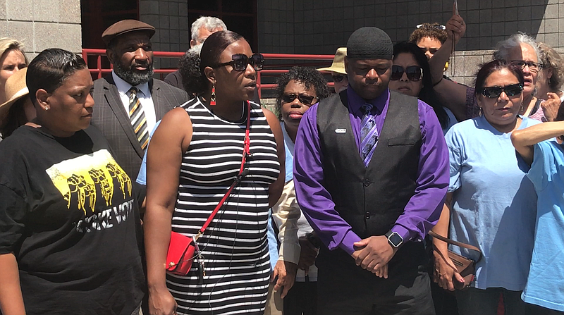 Family of Earl McNeil and community members rally outside of National City Po...