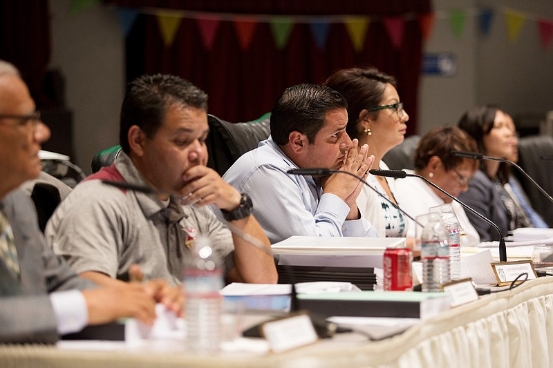 San Ysidro school board members listen to a presentation by Paul Gothold, the...
