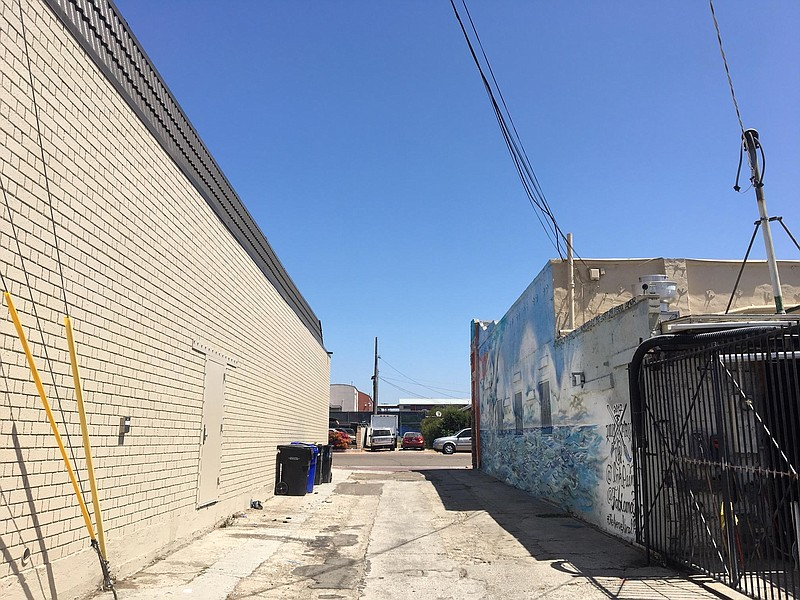 A view of the site for the upcoming mural on an alley-facing wall behind the ...