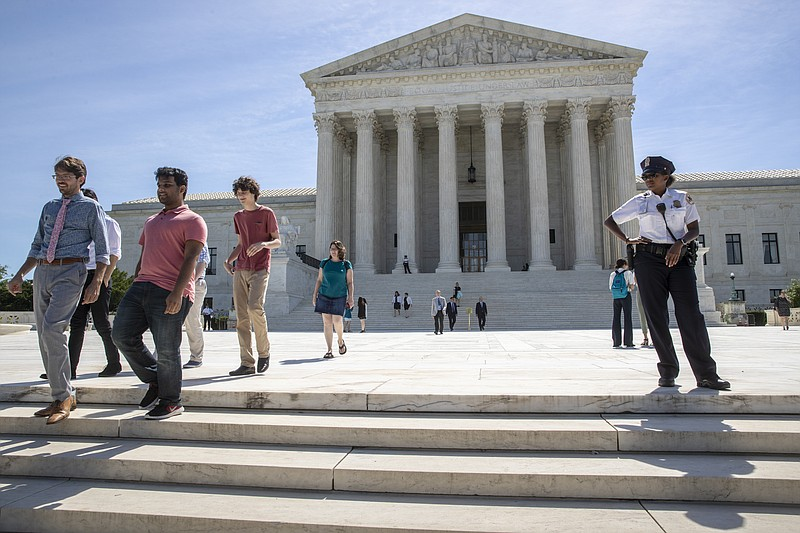Visitors depart the Supreme Court early Monday, June 25, 2018.