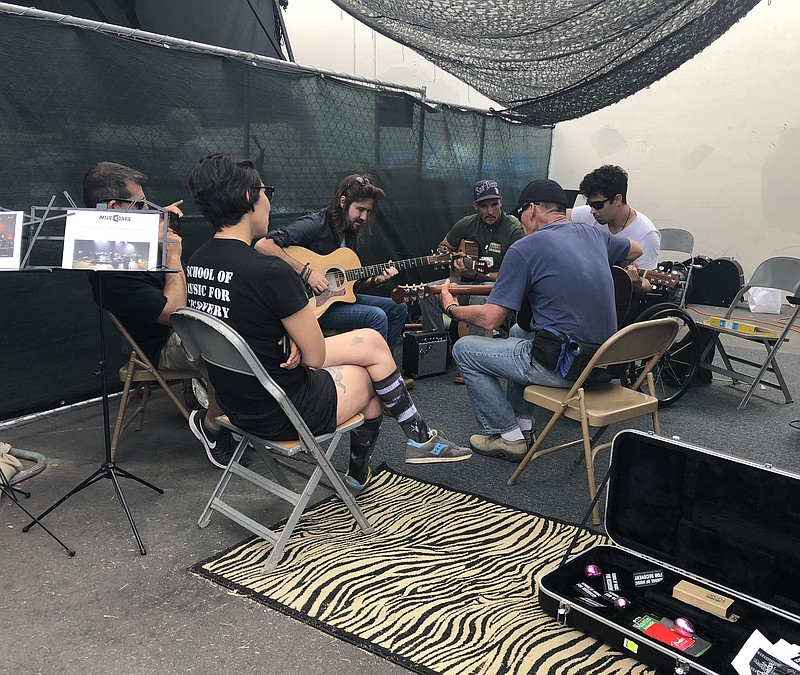 Musicians playing guitar at the 31st annual Stand Down intervention in San Di...