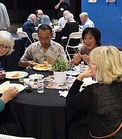 Producers Club members enjoying buffet-style Indian cuisine