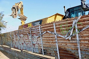 Border Fencing That Honored The Dead Is Torn Down