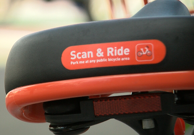 Text on the back of a Mobike seat reads,