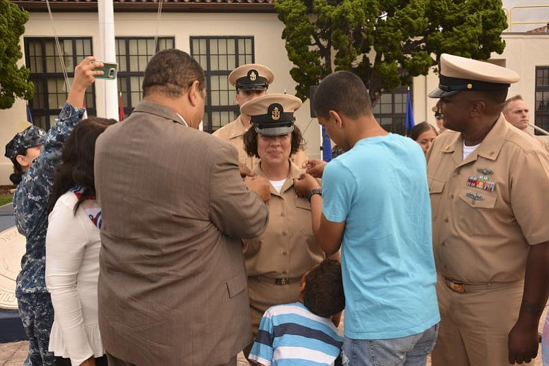 Angelina Gabriel's family surrounds her as she's promoted to the rank of Navy...