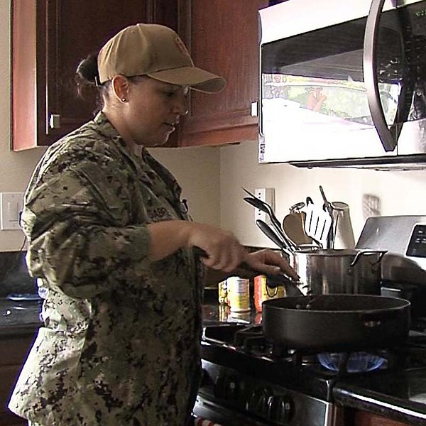 Navy Chief Petty Officer Angelina Gabriel is seen cooking...