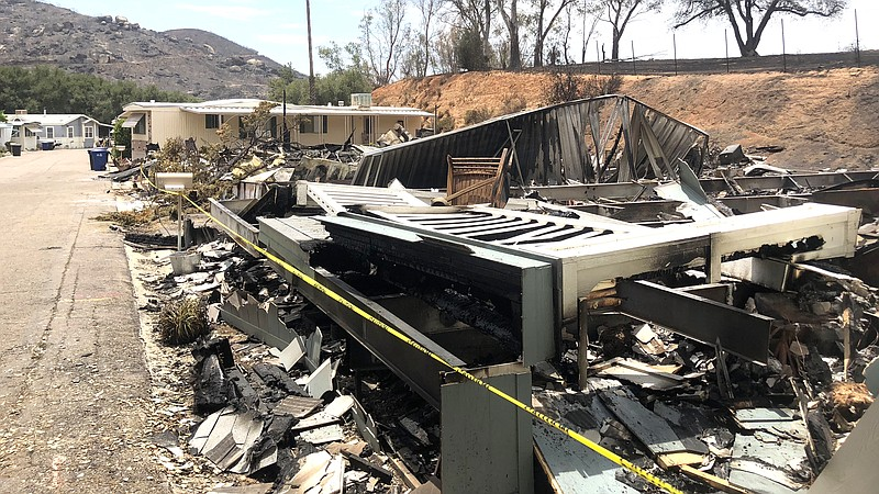 A brush fire in Alpine destroyed mobile homes at the Alpine Oaks Estates incl...