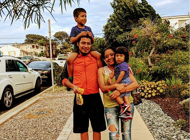 Jose Demar Fuentes is reunited with his sons, July 11, 2018.