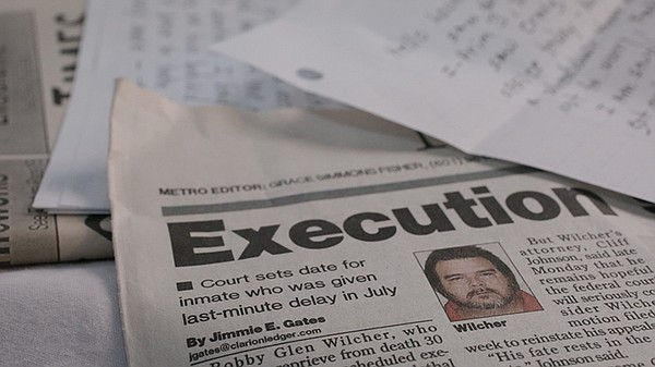 Newspaper with lead story about Bobby Wilcher's case that...