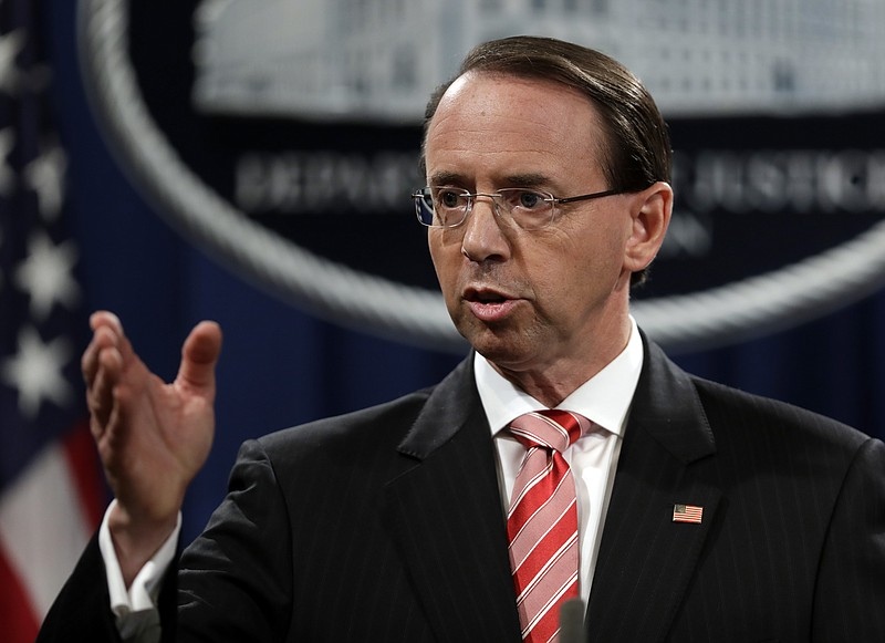 Deputy Attorney General Rod Rosenstein speaks during a news conference at the...