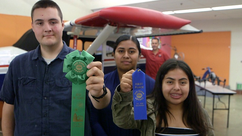 Current and former JROTC students at Vista High School display ribbons they w...