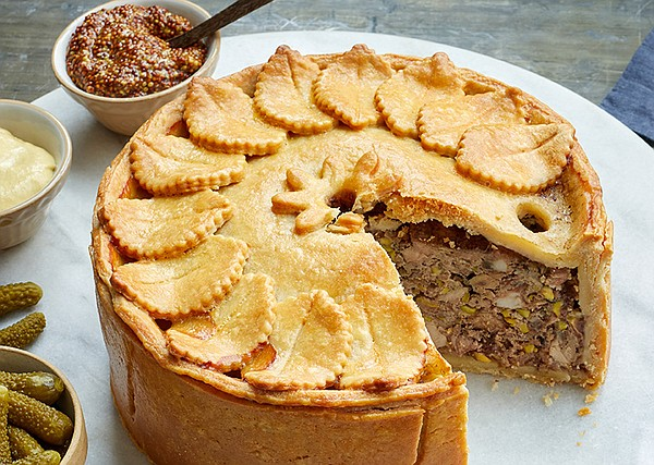 Savory game pie featuring a unique hot water crust