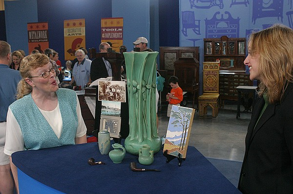 Suzanne Perrault (right) appraises a Teco collection, ca....