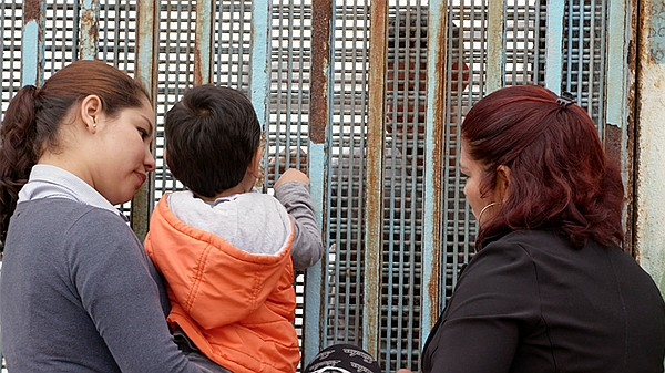 Families at the San Diego, Calif. and Tijuana, Mexico bor...