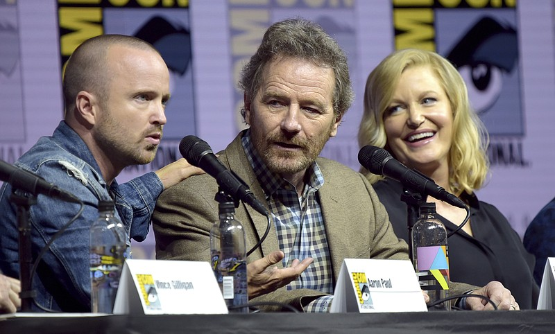 Aaron Paul, from left, Bryan Cranston and Anna Gunn attend the