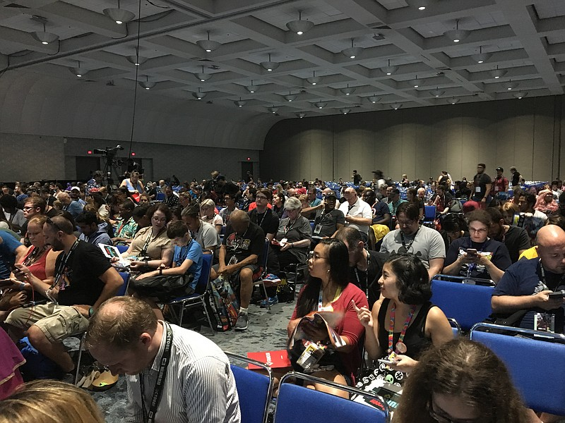 San Diego Comic-Con attendees wait for a Screen Junkies panel to begin, July ...