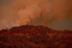 Photo for Sierra Nevada Forest Fire Continues To Grow Near Yosemite