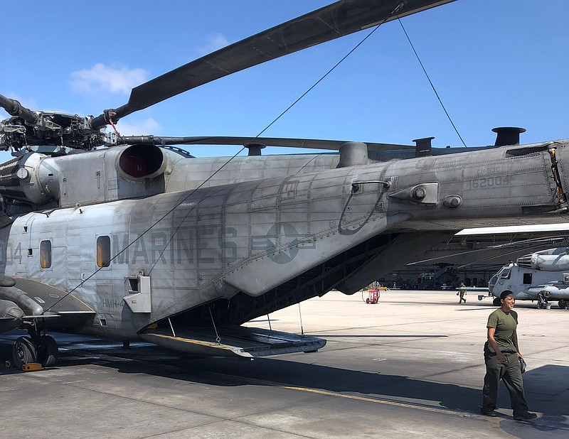 A CH-53 helicopter waits on the tarmac at Marine Corps Air Station Miramar, J...