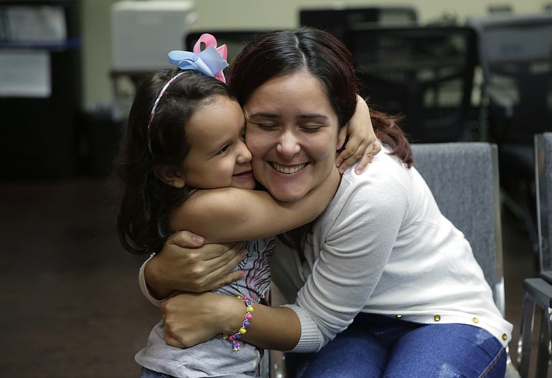 Immigrants seeking asylum Natalia Oliveira da Silva and her daughter, Sara, 5...