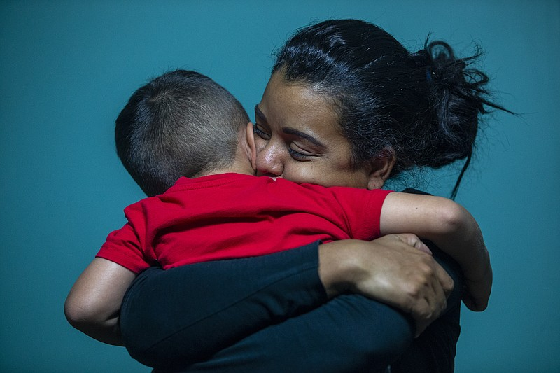 In this July 26, 2018 photo, Evelyn Zepeda cares for a four-year-old boy at h...