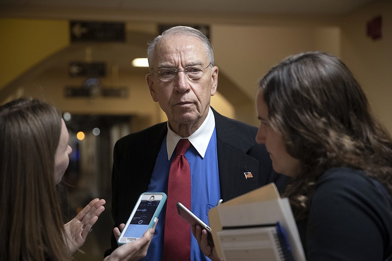 Senate Judiciary Committee Chairman Chuck Grassley, R-Iowa, pauses for report...