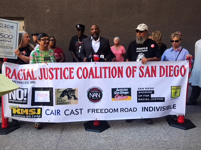 Racial Justice Coalition holds news conference on chokehold ban outside city ...