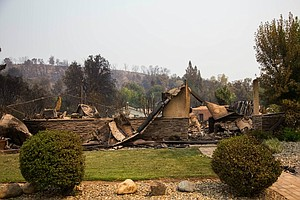 Photo for Does The Government Help Pay To Rebuild Homes Burned Down By Wildfires? Barely.