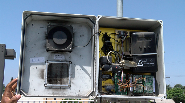An air quality monitor on the roof of Casa Familiar is sh...