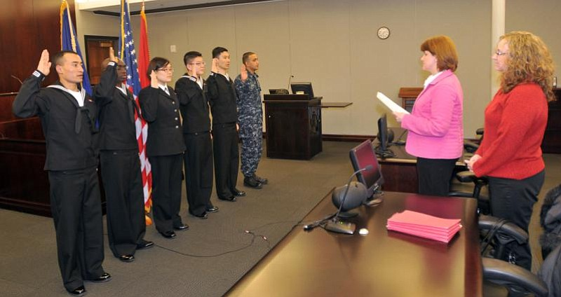 The first Navy sailors to participate in the MAVNI program take their oath of...