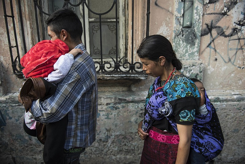 Nazario Jacinto Carrillo carries his 5-year-old daughter Filomena Jacinto Vel...