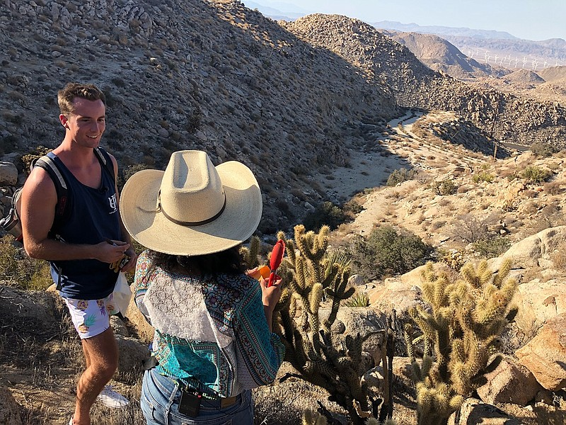 Ryan Buck and Lluvia Flores-Renteria inspect the cholla cactus at the Desert ...